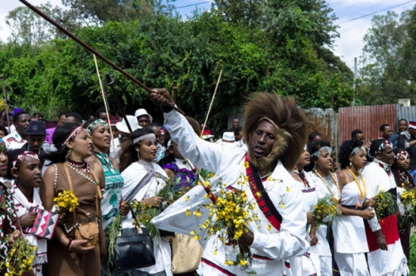 Traditionally decorated Oromos headed by a man with baboon skin head dress
