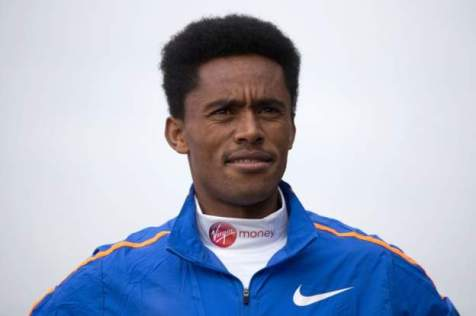 "Ethiopia elite runner Feyisa Lilesa poses during a photocall for the men""s marathon elite athletes outside Tower Bridge in central London on April 20, 2017 ahead of the upcoming London Marathon"
